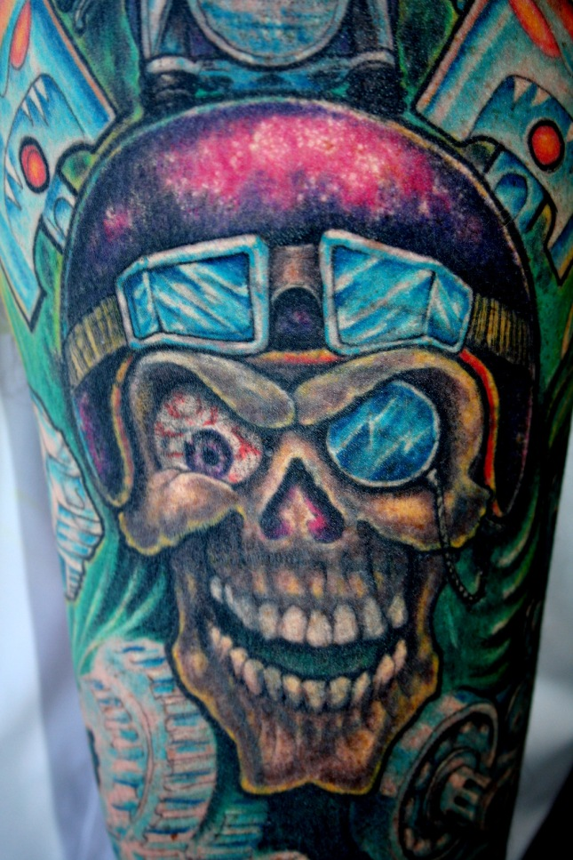 Biker cover up skull tattoo with a helmet on